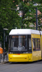 BERLIN - MAY 23, 2012: Yellow tram on city streets. The tram in