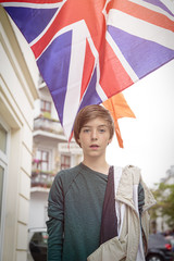 outdoor shot of a teenager boy in front of the british union jac
