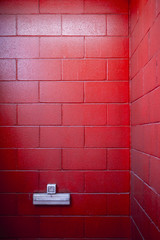 a very red painted brick wall with socket for backgrounds