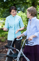 Physiotherapist and senior woman with orthopedic walker