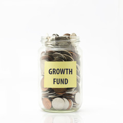 Isolated coins in jar with growth fund label - financial concept