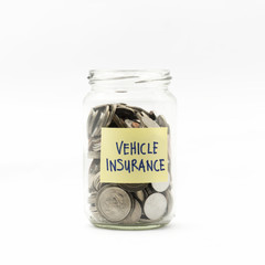Isolated coins in jar with vehicle insurance label - financial c