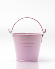 Small pink colored empty bucket isolated in white