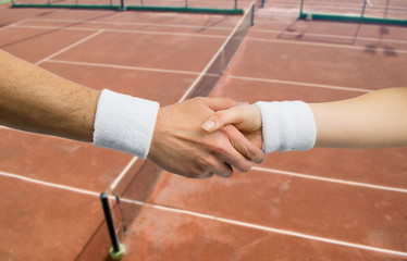 handshake between two tennis player in a competition