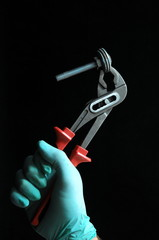 Pliers and a Hand