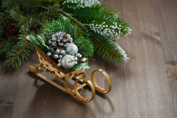 wooden background with fir branches and decoration