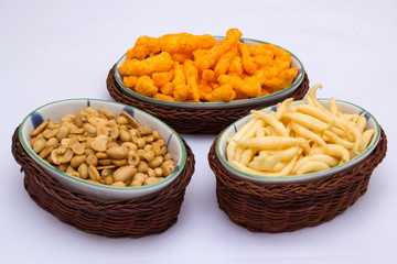 Snacks on ceramic and rattan fancy platter