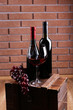 Bottle and glass of wine and ripe grape