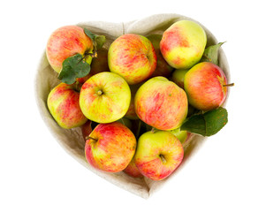 heart-shaped basket of apples