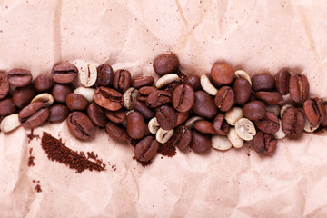 Coffee beans on piece of paper closeup