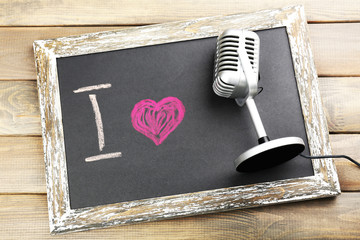 I love singing written on chalkboard, close-up