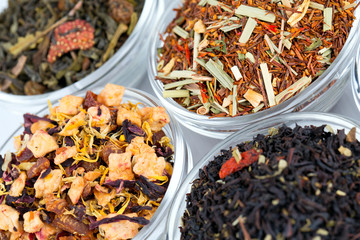 assortment of dry tea in glass bowls