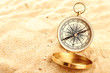 Compass on sand close-up