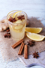Glass of ginger drink with lemon