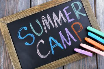Text Summer camp written with chalk
