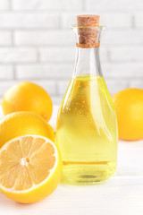 Lemon oil on table on light background