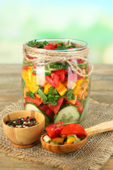 Vegetable salad in glass jar,
