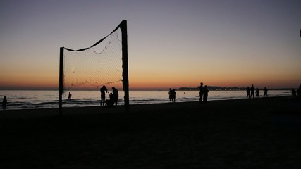 Beachvolleyball at sunset