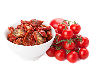 Sun dried tomatoes and ripe tomatoes, isolated on white.