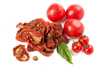 Sun dried tomatoes with basil and ripe tomatoes, isolated on whi
