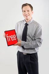 Businessman showing a tablet
