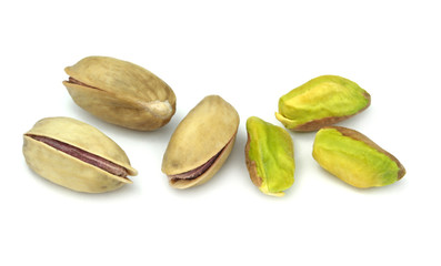 Pistachio nuts ( Real Turkish Antep nuts ) isolated on white