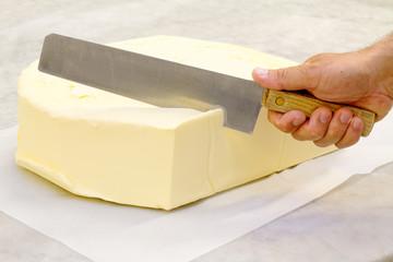 knife cutting big butter shape