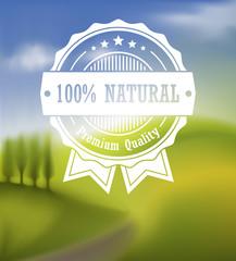 Premium label over blurred landscape background