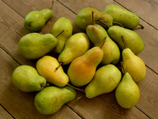 fresh harvested pears on rustic background