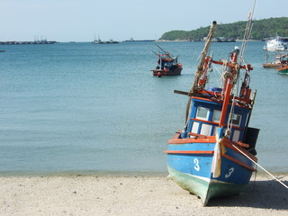 Thai fishing wooden boat at the beach in Thailand.