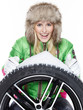 canvas print picture - Woman with winter tyre