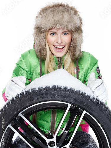 canvas print picture Woman with winter tyre