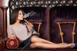 Beautiful young woman inhaling hookah. - 70338865