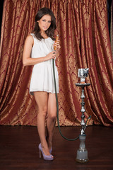 tall young woman holding hookah.