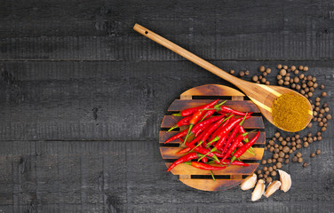 Peppers and garlic on wooden background
