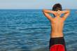 little boy looking the sea