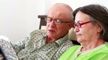 Senior Couple Watching Photo Album