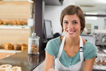 Pretty barista smiling at camera