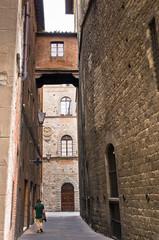 Man walks in narrow street,  Siena, Tuscany