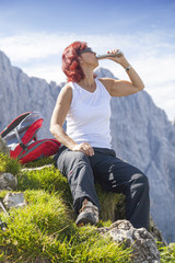 Cute middle aged woman hiker with hip flask