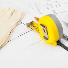 Measure tape with gloves, helmet and pencil - 1 to 1 ratio