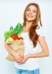 woman hold shopping bag with green vegan food