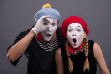 Portrait of sad mime couple crying isolated on grey background