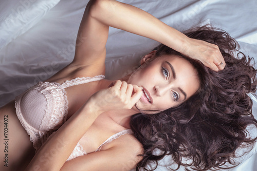 canvas print picture Brunette lady in bed