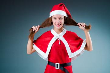 Snow santa girl in red costume