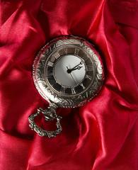 Pocket gray clock on red