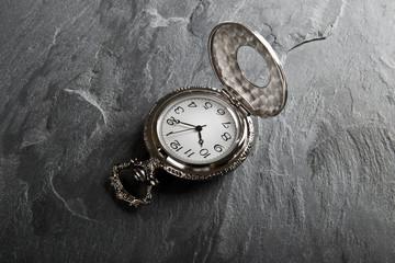 Pocket gray clock on dark gray