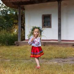 Girl in coronett and national costume