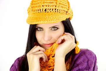 Beautiful woman with hat and scarf smiling