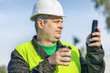 Worker with cup of coffee and cell phone